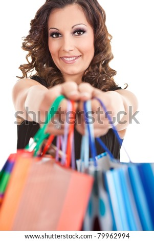 young woman with shopping bags, isolated on white background - stock photo