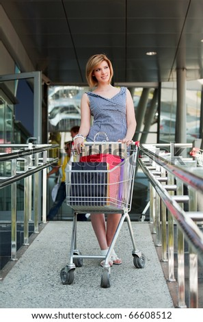 Young woman with shopping cart.