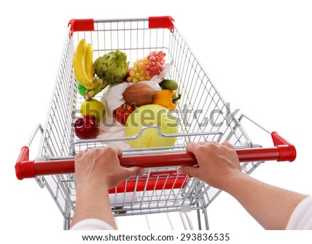 Young woman with shopping cart isolated on white - stock photo
