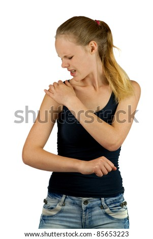 Young woman with shoulder pain on white background - stock photo