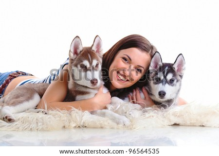 young woman with siberian husky puppy - stock photo