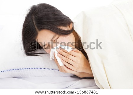 young Woman with sick and laying in bed - stock photo