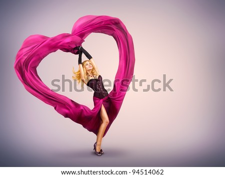 Young Woman with Silk Valentine Heart - stock photo