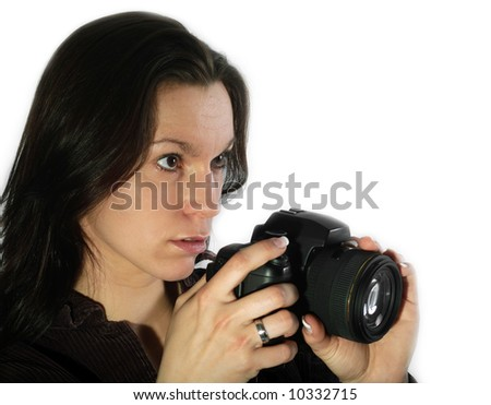 Young woman with single lens reflex camera - stock photo