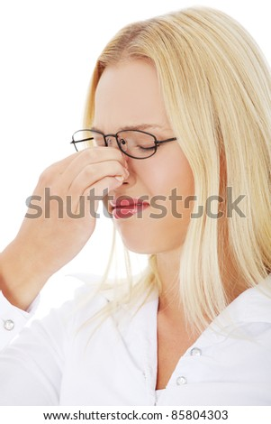 Young woman with sinus pressure pain - stock photo