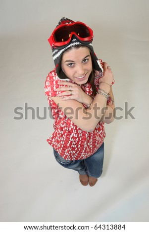 Young Woman with ski goggles - stock photo