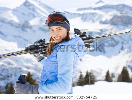 young woman with ski in winter  - stock photo