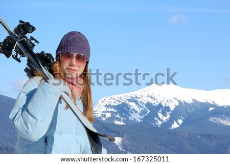 Young woman with ski in winter time