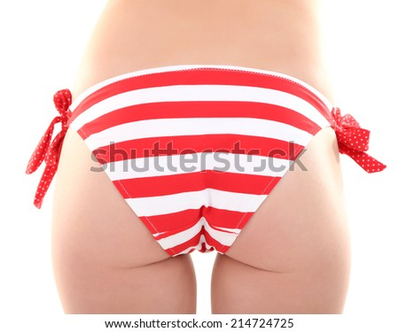 Young woman with slim body in swimsuit isolated on white - stock photo