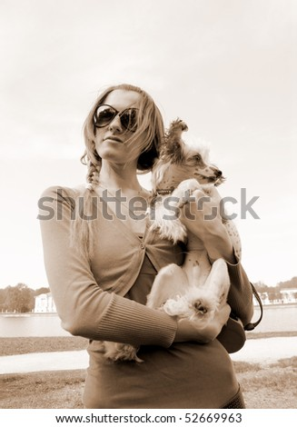 Young woman with small dog outdoor