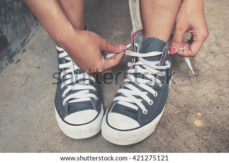 Young woman with sneakers