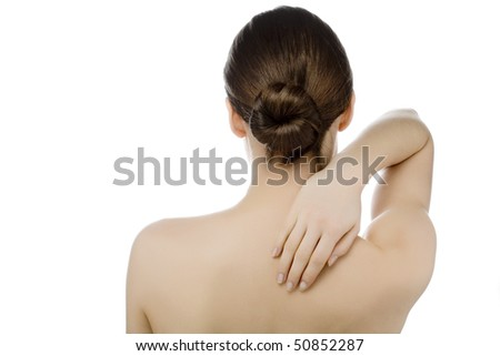 young woman with some pain in neck and back - stock photo