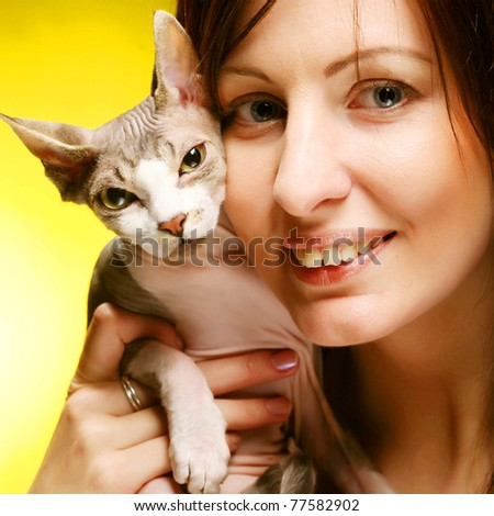 young woman with sphynx  cat
