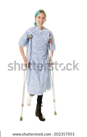 young woman with sports injury to her ankle using crutches, isolated on white