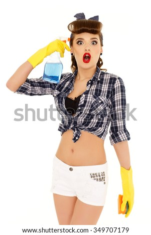 Young woman with spray bottle and sponge on a  white background.  Housekeeping. Cleaning woman. - stock photo