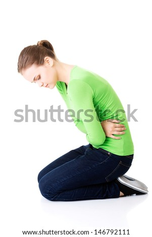Young woman with stomach issues,isolated on white  - stock photo