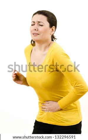 Young woman with stomach / menstrual issues - stock photo