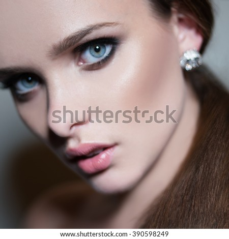Young woman with straight hairand blue eyes - stock photo