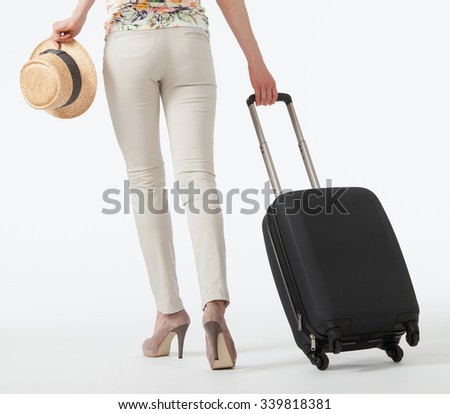 Young woman  with suitcase going away, white background, full length portrait - stock photo