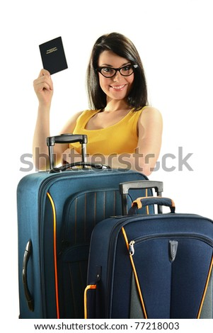 Young woman with suitcases holding passport isolated on white. Female tourist with luggage - stock photo
