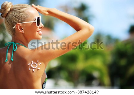 Young woman with sun shape on the shoulder