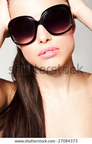young woman with sunglasses - stock photo