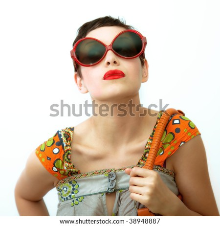 young woman with sunglasses and bag over white background - stock photo