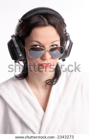 young woman with sunglasses and headphones