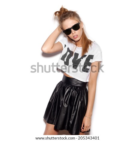 Young woman with sunglasses looking at the camera.  White background, not isolated - stock photo