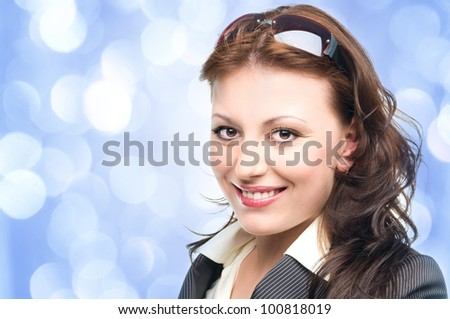 young woman with sunglasses with blue lights in the background - stock photo