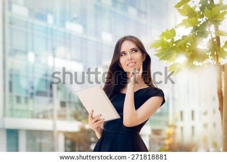 Young Woman with Tablet Out in the City - Woman holding a PC tablet thinking about a strategy