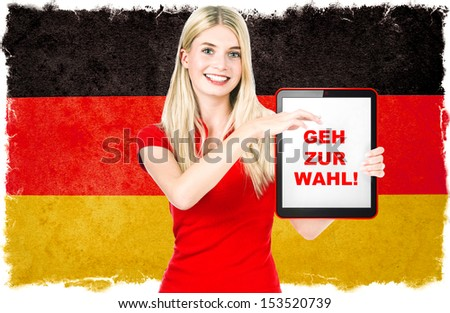Young woman with Tablet PC and Germany flag on background. Sample text Vote! - stock photo