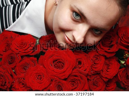 Young woman with the large bouquet of roses - stock photo