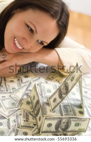 young woman with the money on a white