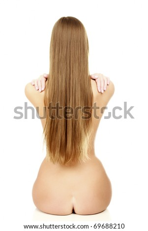 Young woman with the naked back and long hair on white background. - stock photo