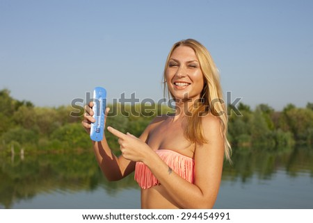 Young woman with thermometer in summer outdoor