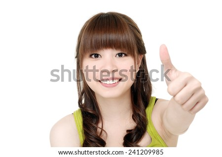 Young woman with thumbs up gesture,  - stock photo