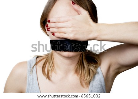 Young woman with tied mouth and blinding her eyes by hand - stock photo