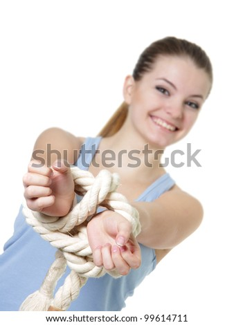 young woman with tied up hands over white - stock photo