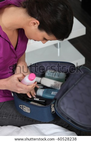 Young woman with toiletry kit