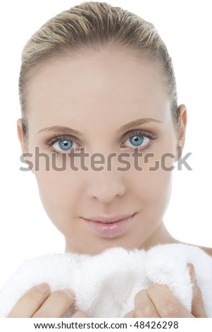 Young woman with towel/bathrobe, close-up - stock photo