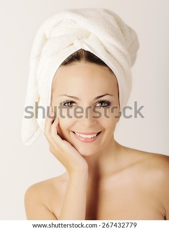 Young woman with towel on her head - stock photo