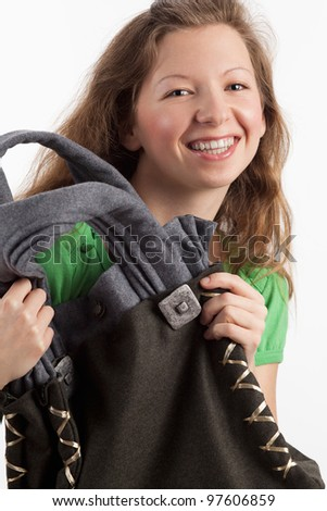 Young woman with traditional bag - stock photo