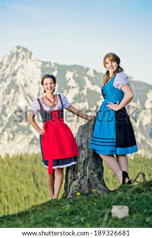 Young Woman with traditional clothes in the Austrian Alps