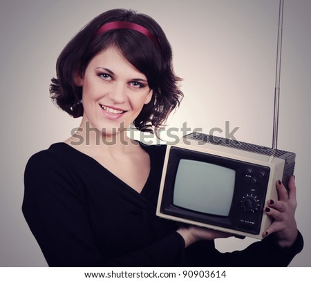 Young woman with tv in retro style - stock photo