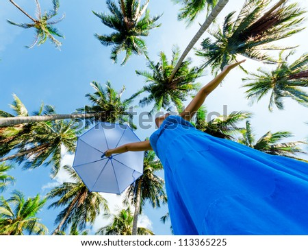 Young woman with umbrella. Outdoor portrait. - stock photo