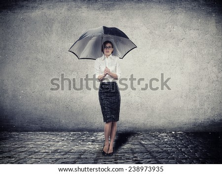 Young woman with umbrella under the rain. Water studio photo. - stock photo