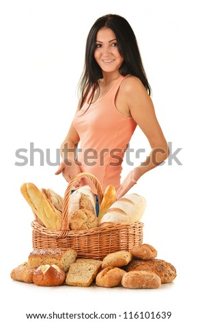 Young woman with variety of baking products isolated on white - stock photo