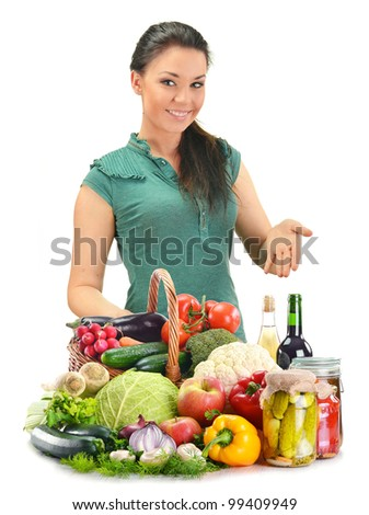 Young woman with variety of food products isolated on white
