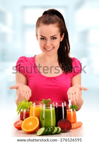 Young woman with variety of vegetable and fruit juices. Detox diet. - stock photo